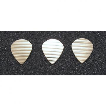 Custom Handmade 3 bronze guitar picks made from damaged cymbals. Jazz III XL style.